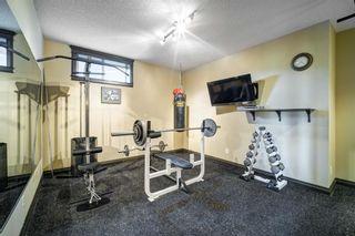 Photo 35: 102 Ridge View Place: Cochrane Detached for sale : MLS®# A1147672