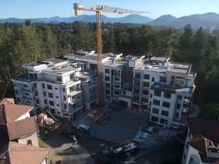 """Photo 1: 202 3182 GLADWIN ROAD in Abbotsford: Central Abbotsford Condo for sale in """"Regency Park"""" : MLS®# R2618258"""