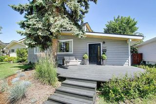 Photo 1: 3940 VINCENT Place NW in Calgary: Varsity Detached for sale : MLS®# A1061054