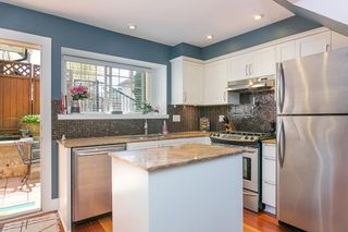 """Photo 1: 1630 E GEORGIA Street in Vancouver: Hastings Townhouse for sale in """"WOODSHIRE"""" (Vancouver East)  : MLS®# R2273211"""