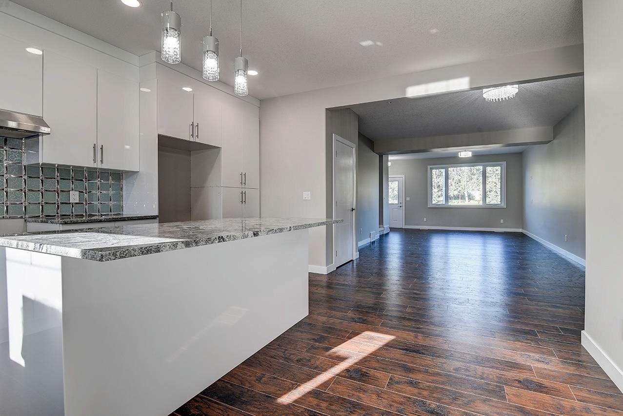Main Photo: 10357 149 Street in Edmonton: Zone 21 House Half Duplex for sale : MLS®# E4246596