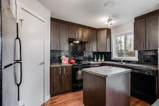 Photo 6: 107 2445 Kingsland Road SE: Airdrie Row/Townhouse for sale : MLS®# A1151788