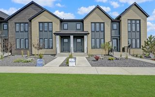 Photo 1: 1042 Harmony Parade in Rural Rocky View County: Rural Rocky View MD Row/Townhouse for sale : MLS®# A1136915