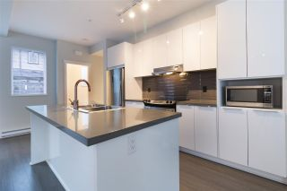 "Photo 1: 60 8138 204 Street in Langley: Willoughby Heights Townhouse for sale in ""Ashbury and Oak by Polygon"" : MLS®# R2230446"