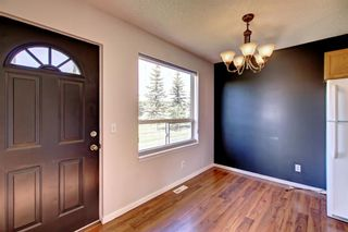 Photo 5: 129 Sandpiper Lane NW in Calgary: Sandstone Valley Row/Townhouse for sale : MLS®# A1106631