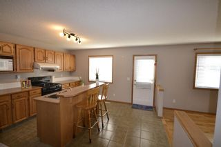 Photo 3: 202 Arbour Stone Rise NW in Calgary: Arbour Lake Detached for sale : MLS®# A1136884