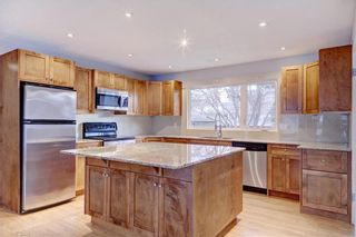 Photo 9: 611 WOODSWORTH Road SE in Calgary: Willow Park Detached for sale : MLS®# C4216444