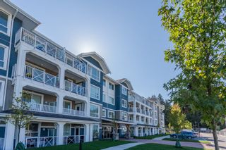 """Photo 1: 307 16396 64 Avenue in Surrey: Cloverdale BC Condo for sale in """"The Ridge at Bose Farms"""" (Cloverdale)  : MLS®# R2002175"""