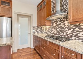 Photo 11: 66 ASPENSHIRE Place SW in Calgary: Aspen Woods Detached for sale : MLS®# A1106205