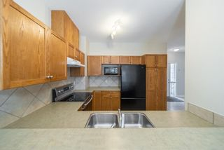 Photo 11: 404 720 Willowbrook Road NW: Airdrie Row/Townhouse for sale : MLS®# A1098346