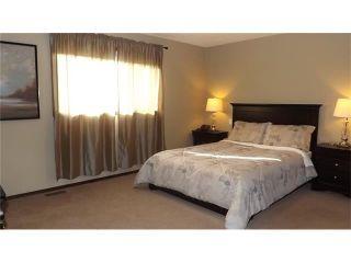 Photo 15: 155 SUNSET Close: Cochrane House for sale : MLS®# C4037159