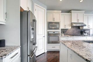Photo 8: 67 Auburn Glen Heights SE in Calgary: Auburn Bay Detached for sale : MLS®# A1128879