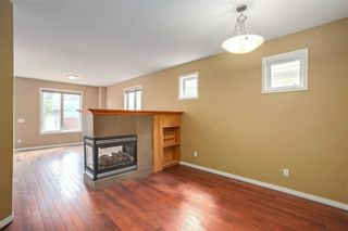 Photo 5: 415 52 Avenue SW in Calgary: Windsor Park Semi Detached for sale : MLS®# A1042308