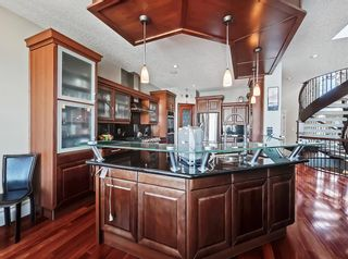 Photo 4: 18 Coulee View SW in Calgary: Cougar Ridge Detached for sale : MLS®# A1145614