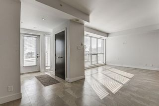 Photo 3: 14609 SHAWNEE Gate SW in Calgary: Shawnee Slopes Row/Townhouse for sale : MLS®# A1010386