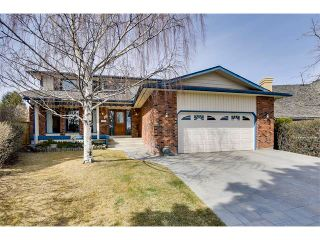 Photo 1: 27 COACHWOOD Place SW in Calgary: Coach Hill House for sale