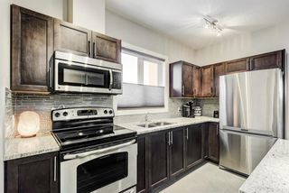 Photo 3: 2202 604 East Lake Boulevard NE: Airdrie Apartment for sale : MLS®# A1061237