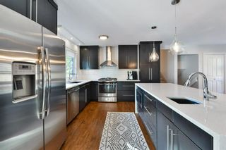 Photo 9: 6128 Lloyd Crescent SW in Calgary: Lakeview Detached for sale : MLS®# A1151128