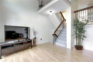 Photo 15: 24 GLAMIS Gardens SW in Calgary: Glamorgan Row/Townhouse for sale : MLS®# A1077235