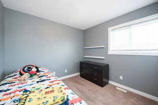 Photo 23: 407 Ranch Ridge Meadow: Strathmore Row/Townhouse for sale : MLS®# A1074181
