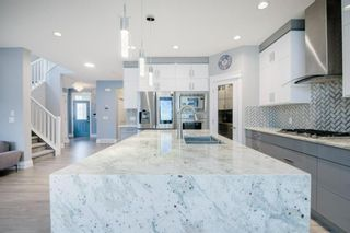 Photo 12: 48 Tremblant Terrace SW in Calgary: Springbank Hill Detached for sale : MLS®# A1131887
