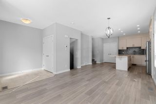 Photo 6: 903 Redstone Crescent NE in Calgary: Redstone Row/Townhouse for sale : MLS®# A1096519