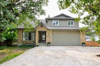 Photo 1: 660 Charleswood Road in Winnipeg: Charleswood Residential for sale (1G)  : MLS®# 202120885
