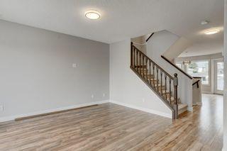 Photo 5: 102 HIDDEN RANCH Road NW in Calgary: Hidden Valley Detached for sale : MLS®# C4294129