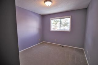 Photo 26: 15 Coach Side Terrace SW in Calgary: Coach Hill Row/Townhouse for sale : MLS®# A1071978