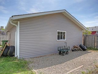 Photo 35: 1103 THORBURN Drive SE: Airdrie House for sale