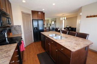 Photo 12: 151 Silverado Drive SW in Calgary: Silverado Detached for sale : MLS®# A1124527