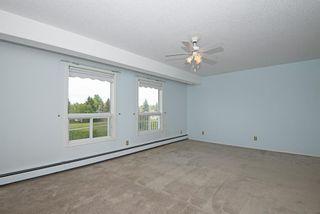 Photo 23: 302 102 Centre Court: Okotoks Apartment for sale : MLS®# A1117894