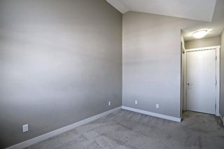 Photo 16: 555 Redstone View NE in Calgary: Redstone Row/Townhouse for sale : MLS®# A1149779