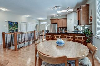 Photo 16: 7 ELYSIAN Crescent SW in Calgary: Springbank Hill Semi Detached for sale : MLS®# A1104538