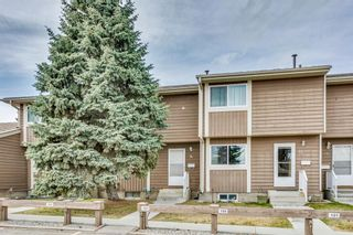 Photo 2: 14 14736 Deerfield Drive in Calgary: Deer Run Row/Townhouse for sale : MLS®# A1092282