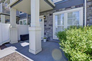 Photo 3: 653 Auburn Bay Boulevard SE in Calgary: Auburn Bay Row/Townhouse for sale : MLS®# A1147022