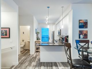 Photo 5: 402 11 Evanscrest Mews NW in Calgary: Evanston Row/Townhouse for sale : MLS®# A1070182