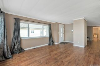 """Photo 3: 28 8254 134 Street in Surrey: Queen Mary Park Surrey Manufactured Home for sale in """"WESTWOOD ESTATES"""" : MLS®# R2397177"""