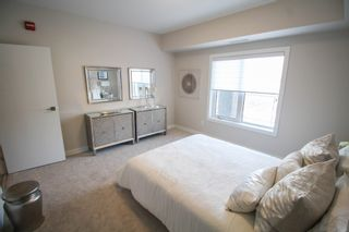 Photo 19: Gorgeous corner unit with wrap around balcony. 1 Underground parking stall included. Pet friendly building.