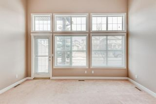 Photo 4: 100 28 Heritage Drive: Cochrane Row/Townhouse for sale : MLS®# A1076913