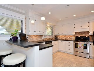 """Photo 2: 12779 14B Avenue in Surrey: Crescent Bch Ocean Pk. House for sale in """"Ocean Park - 1001 Steps"""" (South Surrey White Rock)  : MLS®# F1442520"""