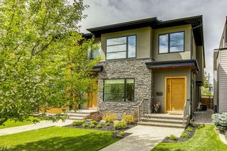 Main Photo: 403 16 Street NW in Calgary: Hillhurst Semi Detached for sale : MLS®# A1131469