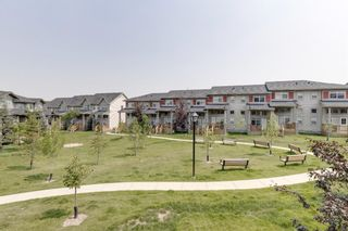 Main Photo: 39 Panatella Road NW in Calgary: Panorama Hills Row/Townhouse for sale : MLS®# A1124667