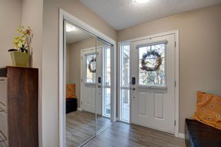 Photo 2: 149 WINDSTONE Avenue SW: Airdrie Row/Townhouse for sale : MLS®# A1033066