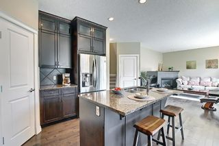 Photo 13: 47 ASPENSHIRE Drive SW in Calgary: Aspen Woods Detached for sale : MLS®# A1106772