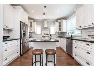 """Photo 12: 7089 179 Street in Surrey: Cloverdale BC House for sale in """"Provinceton"""" (Cloverdale)  : MLS®# R2492815"""