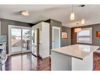 Photo 7: 5612 LADBROOKE Drive SW in Calgary: Lakeview House for sale : MLS®# C4036600