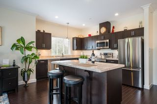 """Photo 10: 411 20281 53A Avenue in Langley: Langley City Condo for sale in """"Gibbons Layne"""" : MLS®# R2621680"""