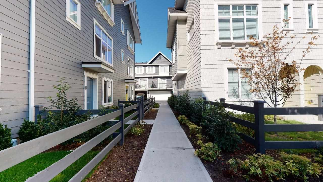 """Main Photo: 64 16678 25 Avenue in Surrey: Grandview Surrey Townhouse for sale in """"FREESTYLE"""" (South Surrey White Rock)  : MLS®# R2506723"""