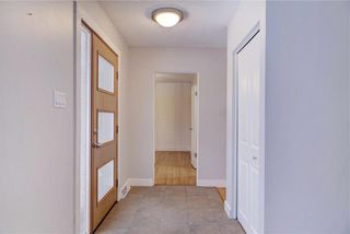 Photo 4: 611 WOODSWORTH Road SE in Calgary: Willow Park Detached for sale : MLS®# C4216444